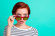 Close Up Portrait Of Attractive She Her Lady Hand On Bright Summer Glasses Specs Hiding Evil Eyes Behind Specs Think Of Trick Know Secret Wearing White Striped Sweater Isolated On Teal Background