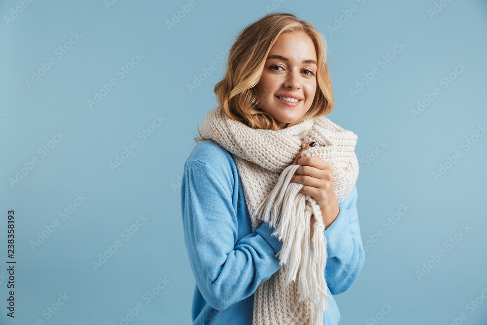 Fototapety, obrazy: Image of blond woman 20s wrapped in scarf smiling at camera, isolated over blue background