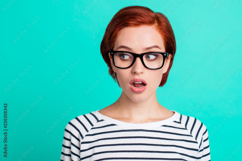 Fototapeta Headshot photo portrait of staring aside to the left copy space amazed shocked with shirt hairstyle raised eyebrows she her person in modern apparel isolated teal vivid background