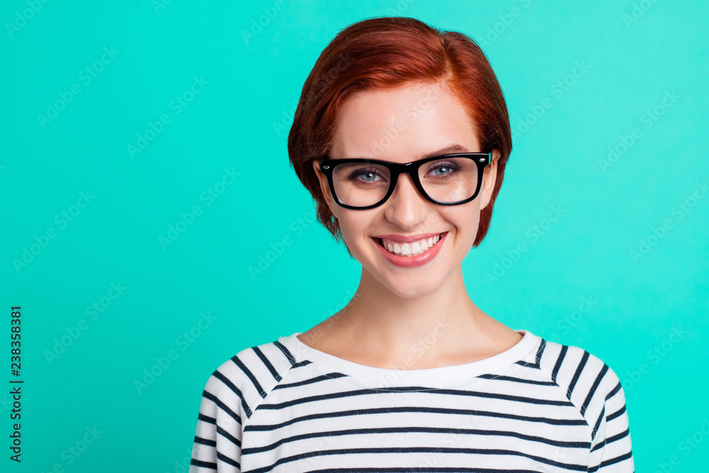 Fototapeta Closeup studio picture portrait of clever pretty charming nice cheerful excited with teeth toothy smile she her people looking at camera isolated bright color teal background copy space
