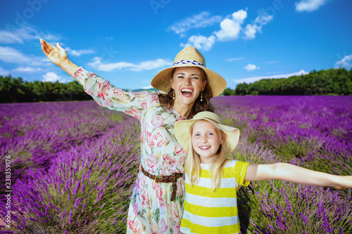 mother and daughter in lavender field rejoicing Canvas Print
