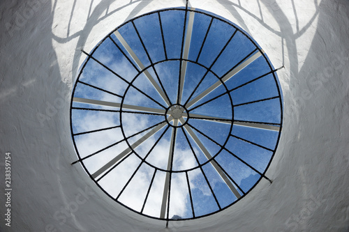 Round roof window with a view of the sky and clouds Fototapeta