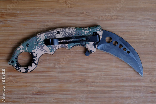 Fotografie, Obraz  Folding knife on a wooden background.