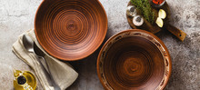 Banner Of Dishes Of Red Clay On A Stone Table With Spices. Handmade Tableware