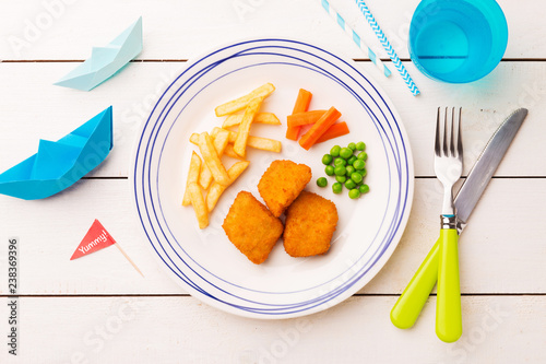 Kid's meal (dinner) - fish, chips, carrot and green peas