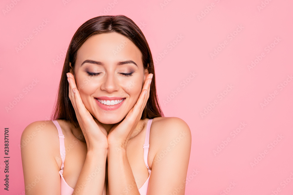 Close up portrait of tender cute gorgeous  touching cheeks with delight about smooth skin her she girl wearing pale pink bra isolated on rose background