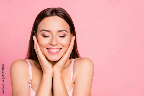Fotografia  Close up portrait of tender cute gorgeous  touching cheeks with delight about sm