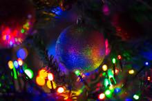 Multi-colored Rainbow Christmas Ball. New Year, Christmas, Festive Background.