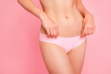 Cropped Close Up Photo Of Touching With Hands Soft Nice Beautiful Attractive Silky Hips Legs Abdomen Weightloss Advertising She Her Woman In Pants Isolated On Rose Background