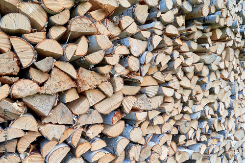 Wall Murals Firewood texture Large pile or stock of firewood for heating furnace. Logs and logs of birch. The log is split in half. Slice as a circle, semicircle. Background, backdrop, texture. Side view.