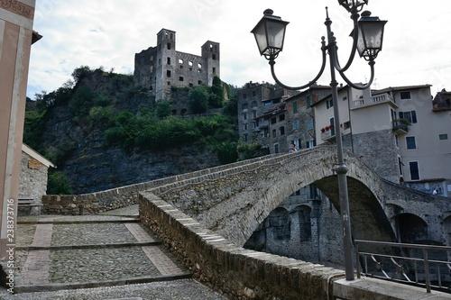 Italy. Dolceacqua. Doria Castle behind Monet's Hunchback Bridge Fototapet