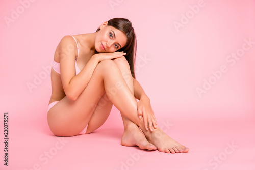 Obraz Full length body size photo of sitting on floor tender gorgeous attractive tempting she her girl with groomed feet foot hands with great figure shape in pale pink bra isolated on rose background - fototapety do salonu