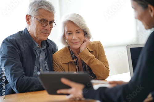 Modern senior couple going through remodelling ideas on tablet Canvas