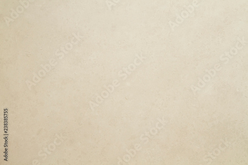 Beige colored tiled wall texture or background Canvas Print