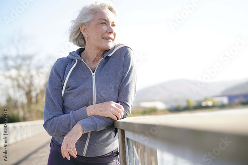 Photographie  Portrait of attractive senior woman in sportswear outdoors