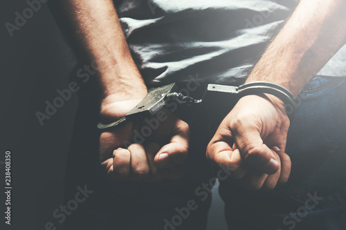 Fotografija man hand handcuffs