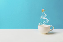 Cup Of Tea Or Coffee With Steam In Fir Tree Shape With Gingerbread Cookies On Blue Background. Christmas Celebration Concept. Copy Space. Toned