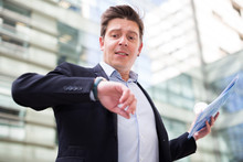 Businessman Hurrying To Meeting And Watching On Wristwatch