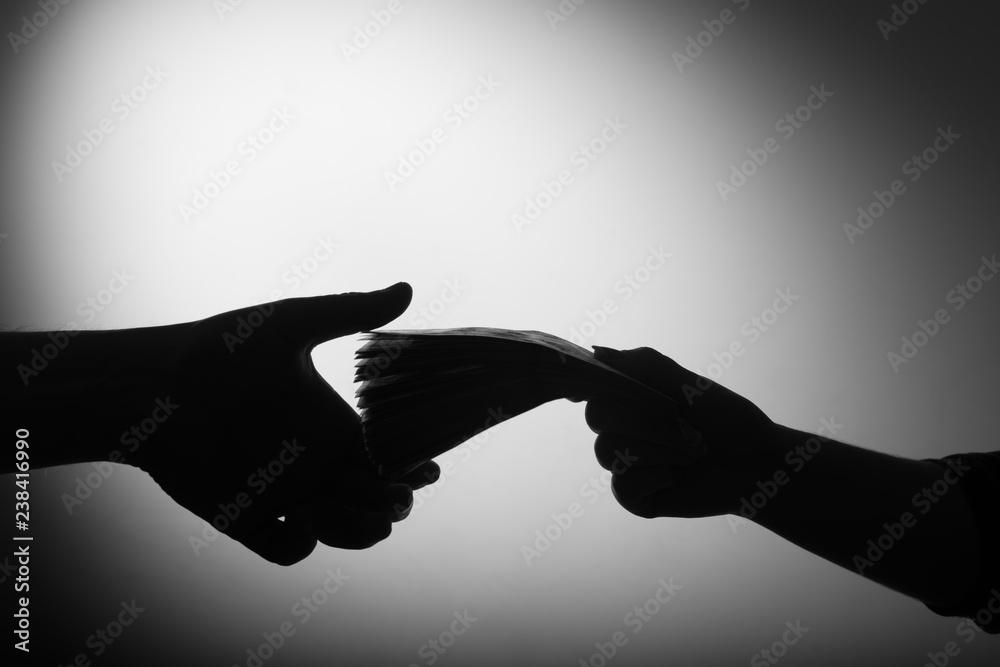Fototapeta dark economy. Two hands with money
