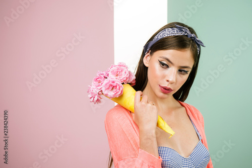 348a8a1a37 pinup girl with fashion hair. pin up woman with trendy makeup. flower  bouquet. Florist. Summer. retro woman eating ice cream from flowers. pretty  girl .