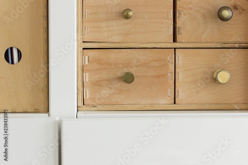Fotografia, Obraz  cabinet with drawers on wooden background