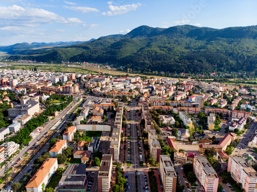 Foto  Mountain city panorama in summer