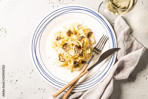Tagliatelle pasta with black truffles and parmesan cheese