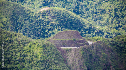 Fotobehang Olijf Yungas Road, also known as 'Death Road' due to its notoriously high death rate, was cut into the side of the Cordillera Oriental Mountain chain in the 1930s
