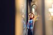 Leinwandbild Motiv Thoughtful girl looking through window while sitting in public transportation.