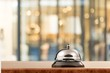 Vintage hotel reception service desk bell on