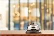 Vintage hotel reception service desk bell on