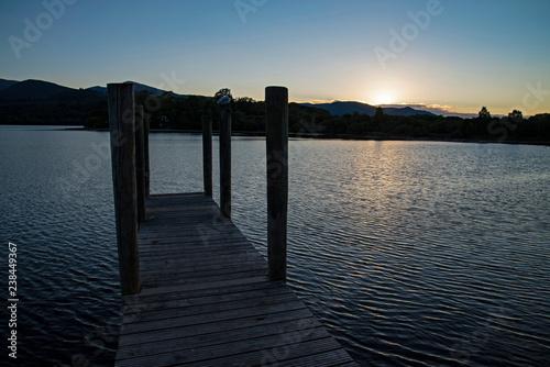 Photographie derwent water pier at sunset