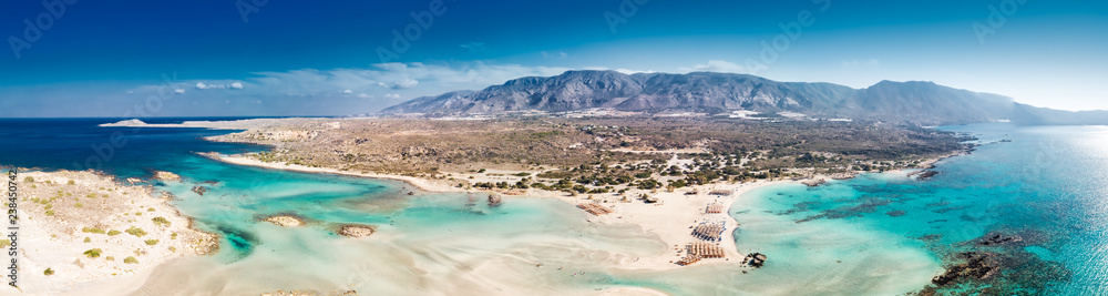 Fototapeta Aerial view of Elafonissi beach on Crete island with azure clear water, Greece, Europeof Elafonissi beach on Crete island with azure clear water, Greece, Europe