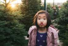 Young Girl Blows A Kiss