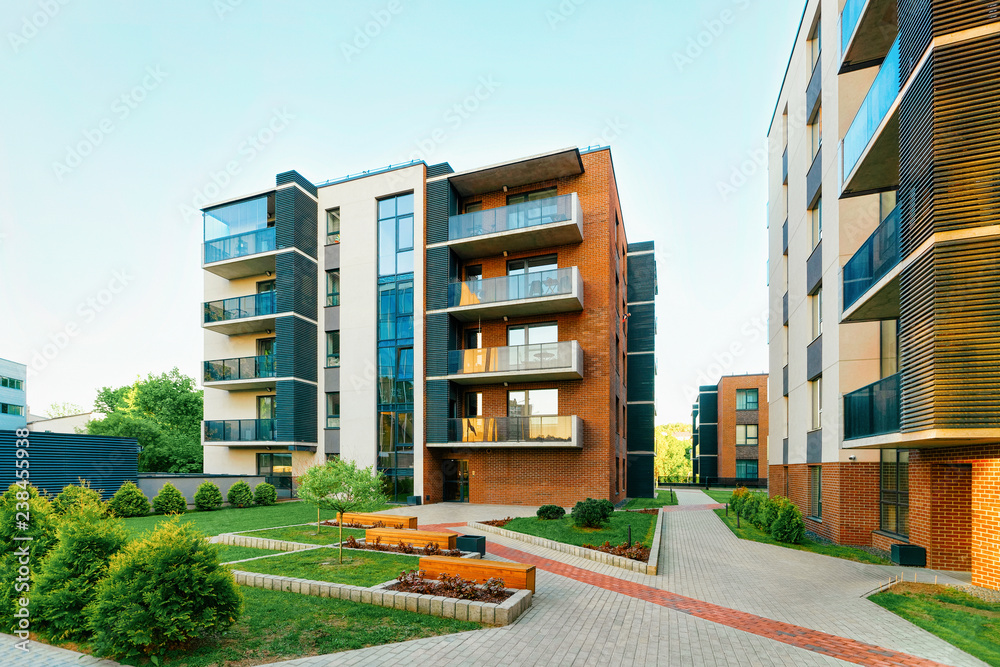 Fototapeta Modern new residential apartment house building complex outdoor facility bench