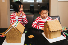 Siblings Decorating A Gingerbr...