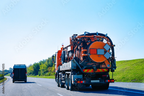 Photo  Vacuum waste truck on highway road in Slovenia
