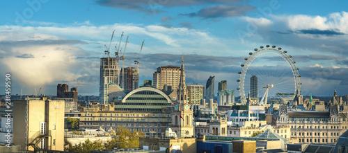 Obraz na plátně London, UK; October 2018: London skyline with London eye at cloudy day