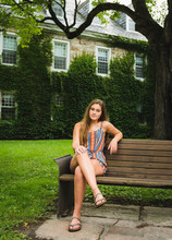 Portrait Of Woman Sitting On B...