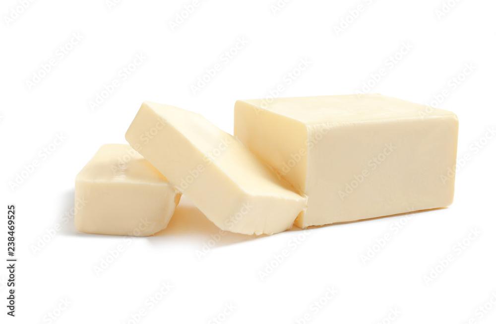 Fototapeta Cut block of fresh butter on white background