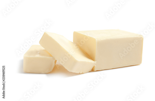 Cut block of fresh butter on white background