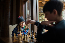 Siblings Playing Chess By Wind...