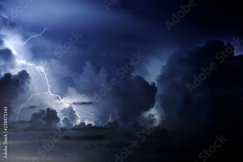 Low angle view of lightning in sky at night - 238475343