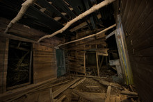 Abandoned Wooden House In Fore...