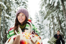 Smiling Young Woman In Warm Clothing Standing Outdoors