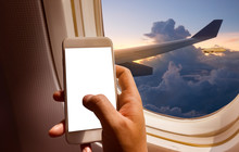 Hand Holding Mobile Phone With Blank Screen Neary Window Seat In Plane