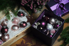 High Angle View Of Colorful Baubles With Christmas Decorations On Table At Home