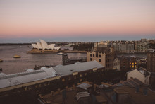 High Angle View Of Cityscape By Sydney Harbor Against Clear Sky During Sunset