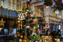Vienna, Austria - December 21, 2017. Showcase With Christmas Tree Decoration And Lighting Garlands By Wintertime. Glass Display With Xmas Ornaments And Lights.