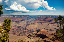 Scenic View Of Rock Formations On Desert Against Cloudy Sky At Grand Canyon National Park